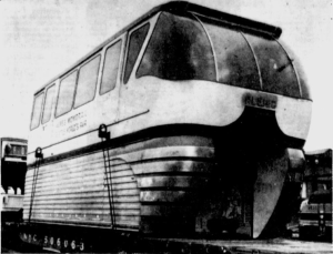 A GN freight train carries the front car of a monorail through Spokane in route to Seattle. Photo Credit: Spokane Daily Chronicle (2/17/62)